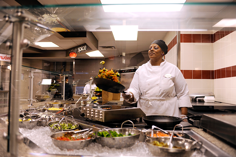 Adelphi dining services chef flipping food